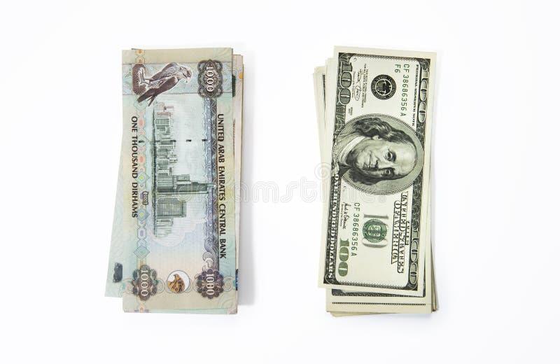 Dirhams och dollar royaltyfri fotografi