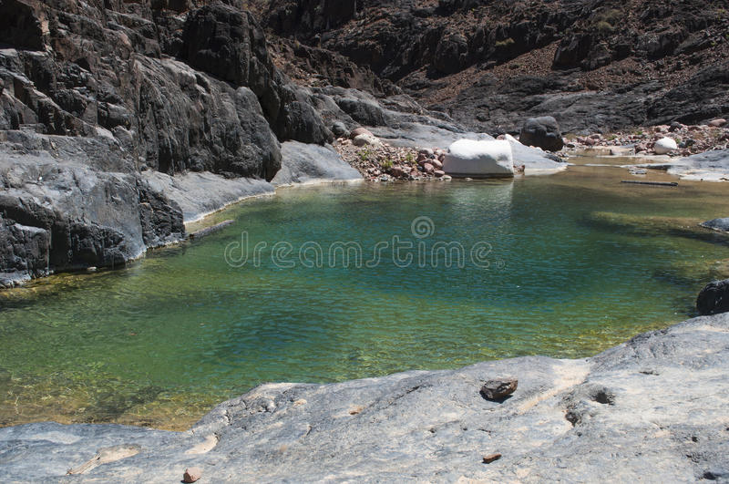 Dirhur, Socotra, island, Indian Ocean, Yemen, Middle East. Yemen, 07/02/2013: view of the Dirhur mountain lake, the wadi, in the Dragon Blood trees forest in the royalty free stock photography