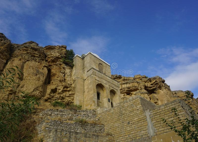 Diri Baba Mausoleum from Down to Upside. Diri Baba Mausoleum on a Cliff from Down to Upside View royalty free stock photo