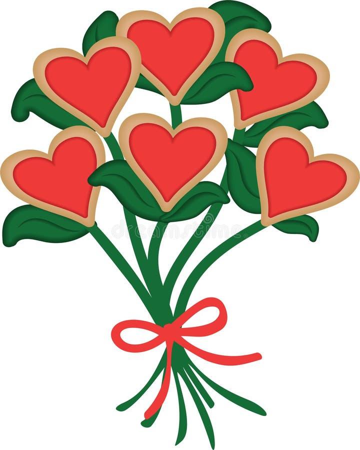 Dirigez les biscuits en forme de coeur rouges a arrangé dans un bouquet de biscuit avec le ruban rouge pour le jour de valentines photo libre de droits