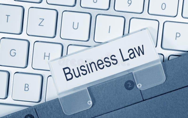 Diritto commerciale - cartella con testo sulla tastiera di computer fotografie stock libere da diritti