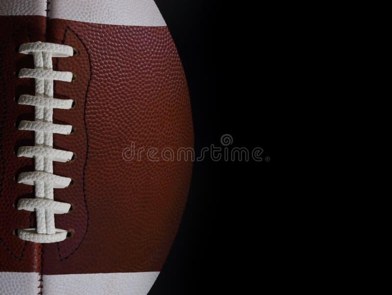Diritto vista di una palla del gioco di football americano con Copyspac fotografia stock