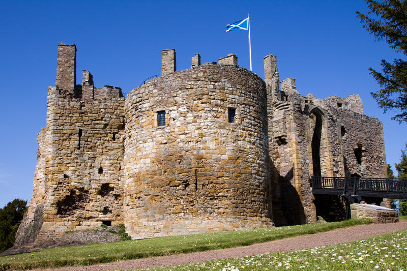 Dirleton Castle. East Lothian, Scotland with a saltire flag visible from a tower. Dirleton was founded as a medieval fortress by the de Vaux family around 1240 stock images