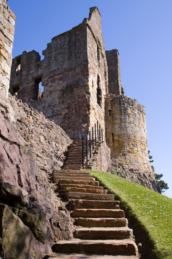 Dirleton Castle. East Lothian, Scotland with a saltire flag visible from a tower. Dirleton was founded as a medieval fortress by the de Vaux family around 1240 stock photography