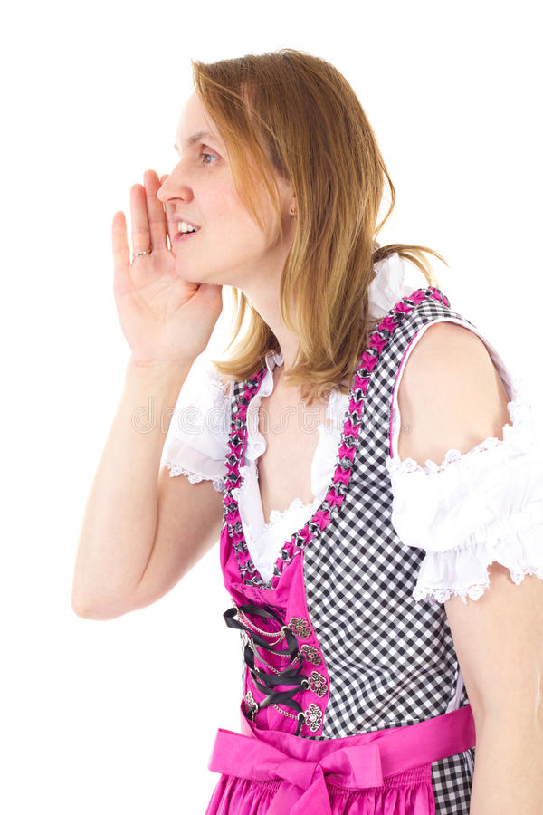 Dirndl vestindo da mulher que sussurra a seu amigo fotos de stock