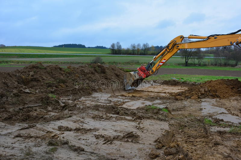 Dirt bulldozer construction foundation stock photo