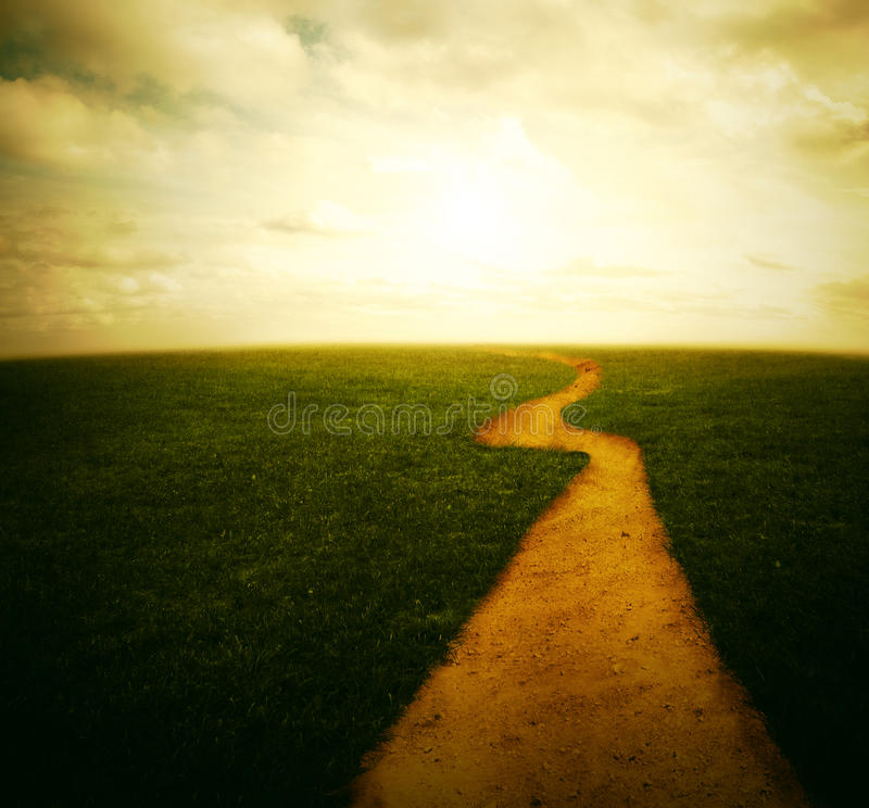 Dirt pathway to the sunset royalty free stock photo