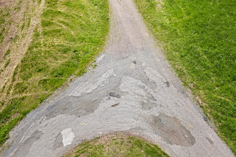 Dirt road crossroads seen from above. royalty free stock photos