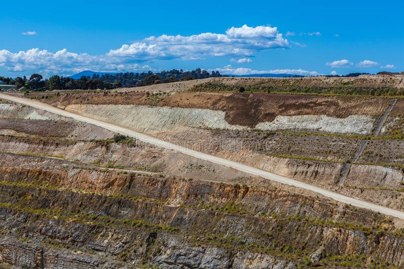 Dirt road down to the bottom of limestone mine. stock photo