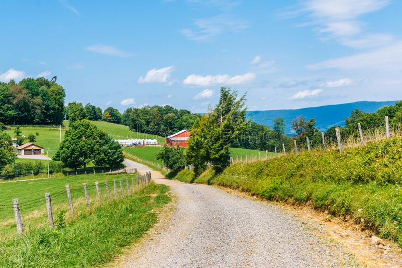 Dirt road and farms in the rural Potomac Highlands of West Virginia.  royalty free stock images