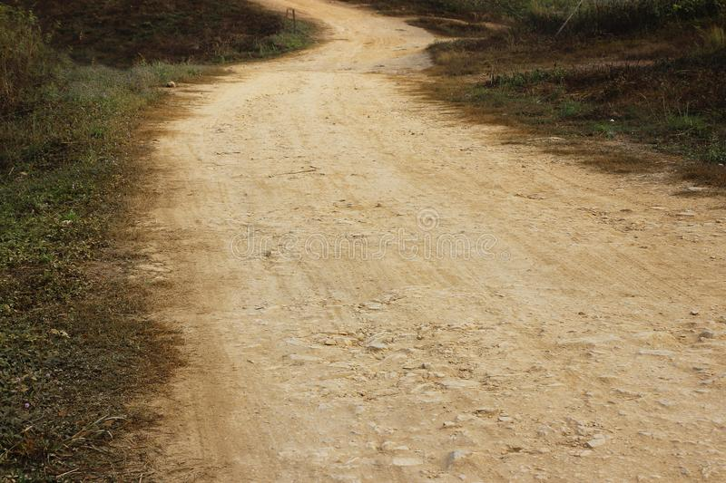 Dirt road through grassland stock photos