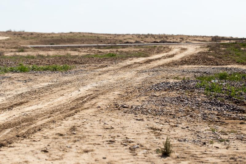 Dirt road on the ground in nature.  royalty free stock image