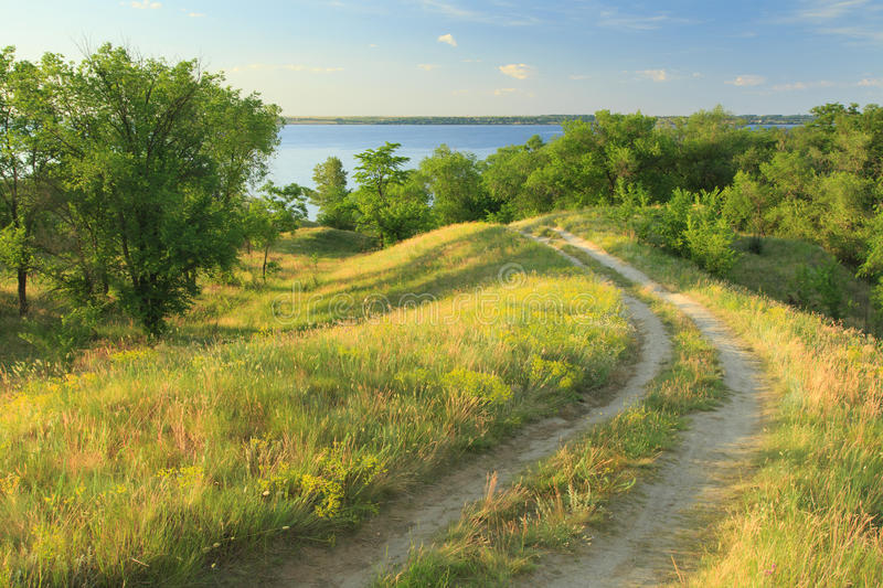 Dirt road in the hills. Near the river royalty free stock image