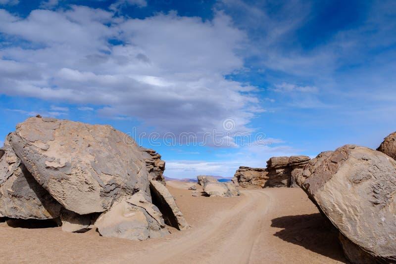 Dirt road between large rocks royalty free stock image