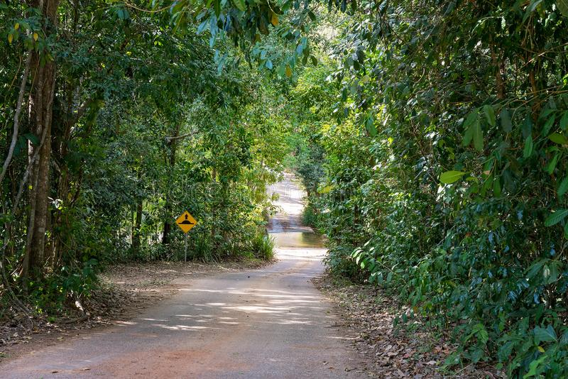 Dirt Road Leading Down To A Causeway Over A Creek royalty free stock photo
