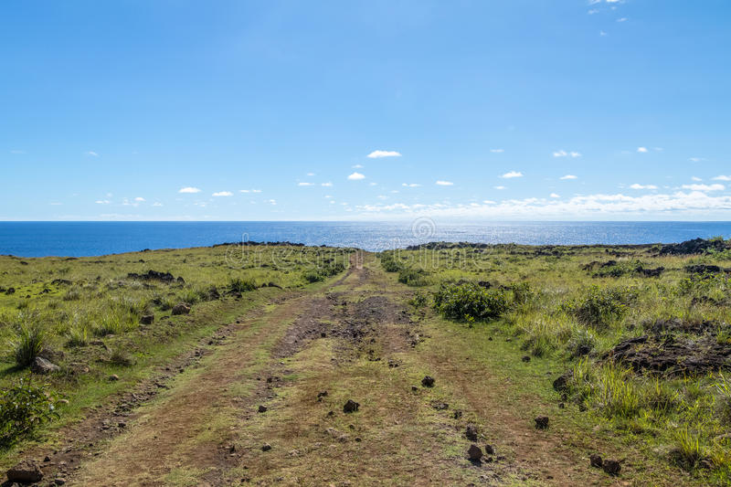 Dirt Road leading to the ocean - Easter Island, Chile royalty free stock photo