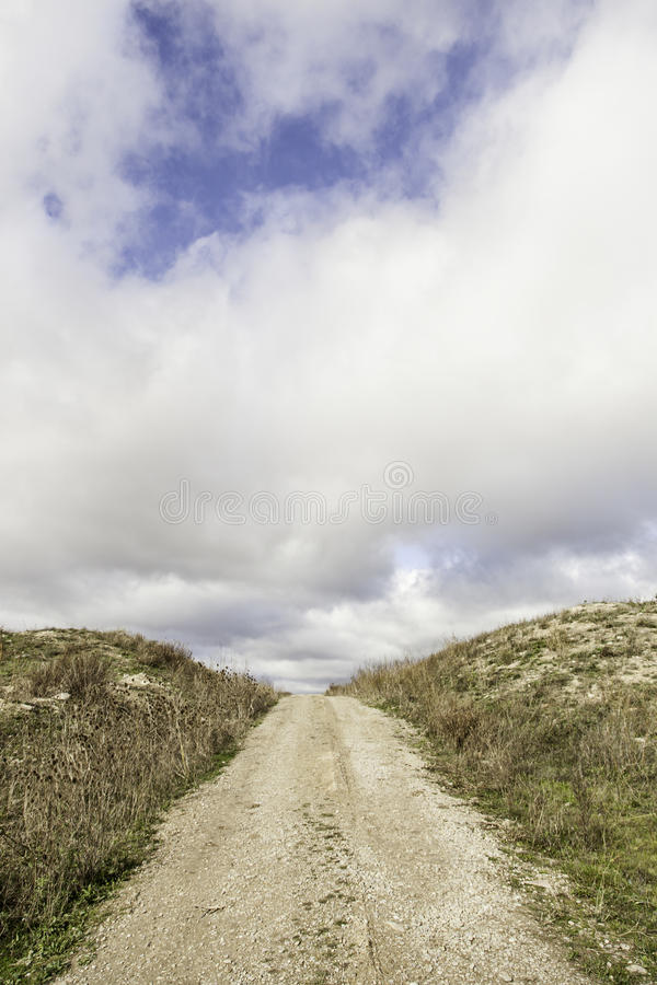 Dirt road mountain stock photography