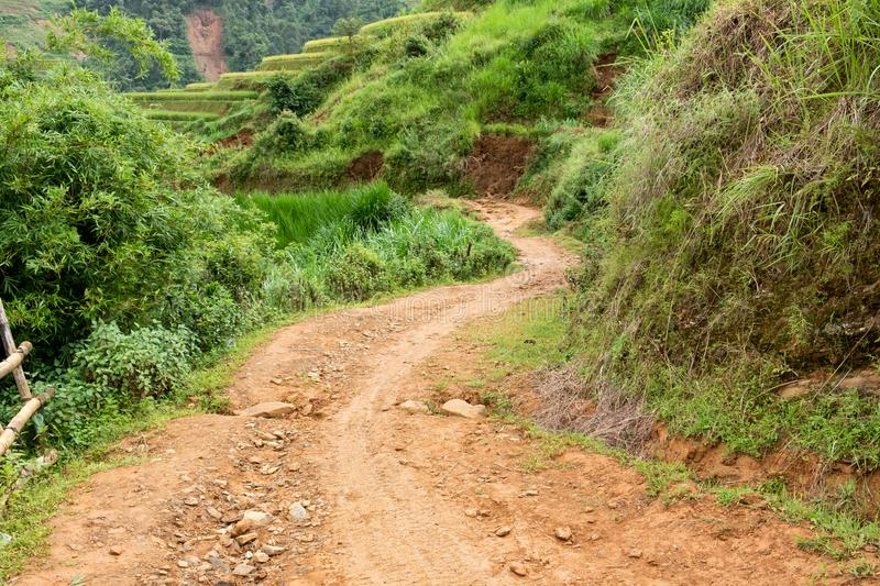 Dirt road with mud in valley royalty free stock photo