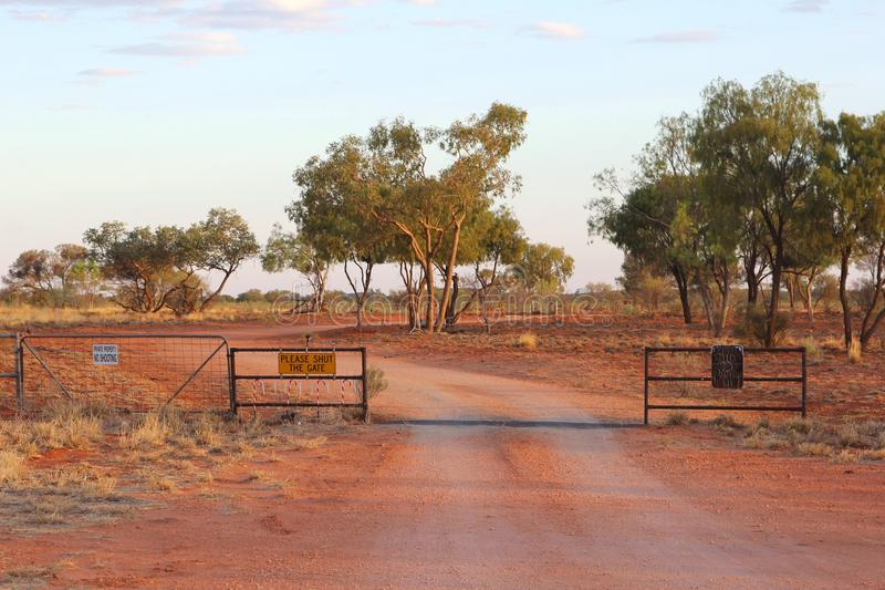Dirt road in the Red Centre of the Australian Outback. Between Glendambo and Stuarts Well Roadhouse along the Stuart Highway. During sunset stock image