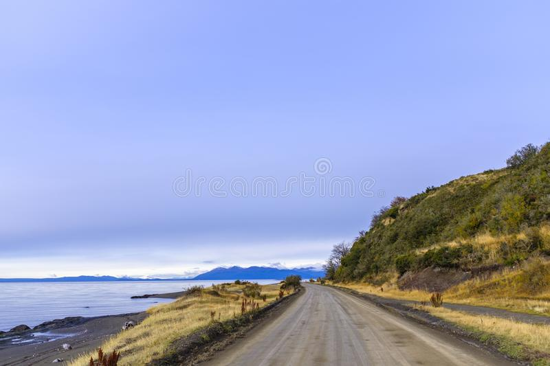 Dirt road by a sea shore royalty free stock images