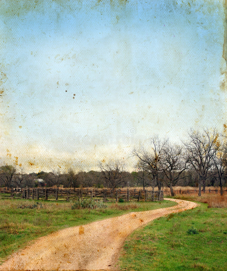 Dirt Road and Splitrail Fence on Grunge background royalty free stock photos