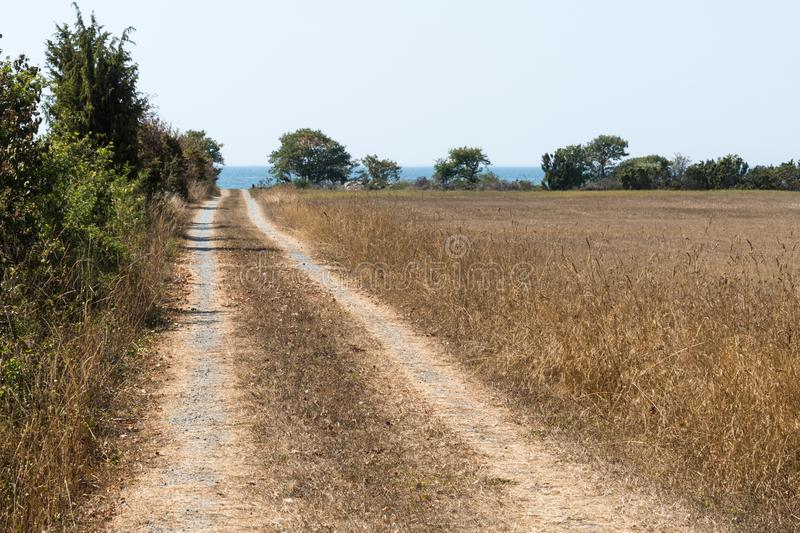 Dirt road to the coast stock photography