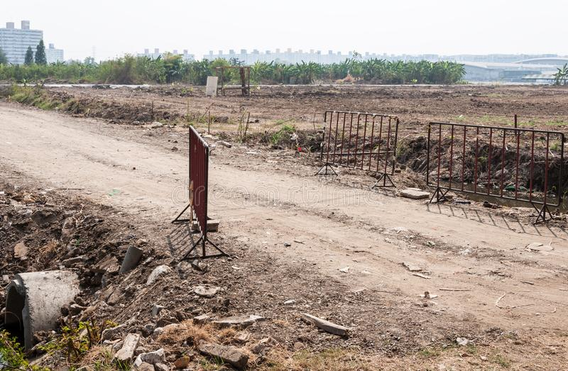 Dirt road to the construction site. stock photos