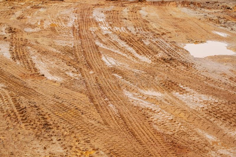 Dirt Road, Urban Non Asphalt Traffic Way with Tire Tracks of Many Type of Vehicles stock images