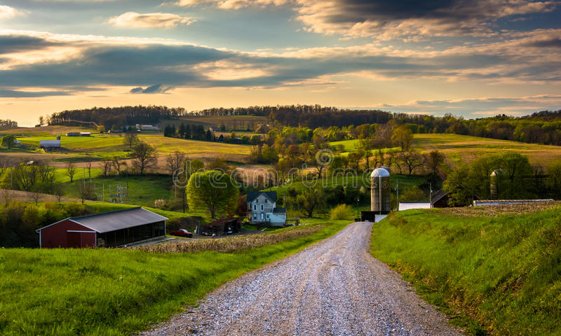 Dirt road and view of farm fields in rural York County, Pennsylvania. stock image
