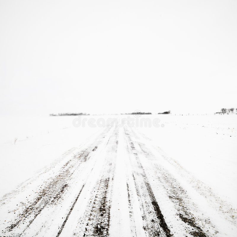 Dirt road in winter storm. royalty free stock images