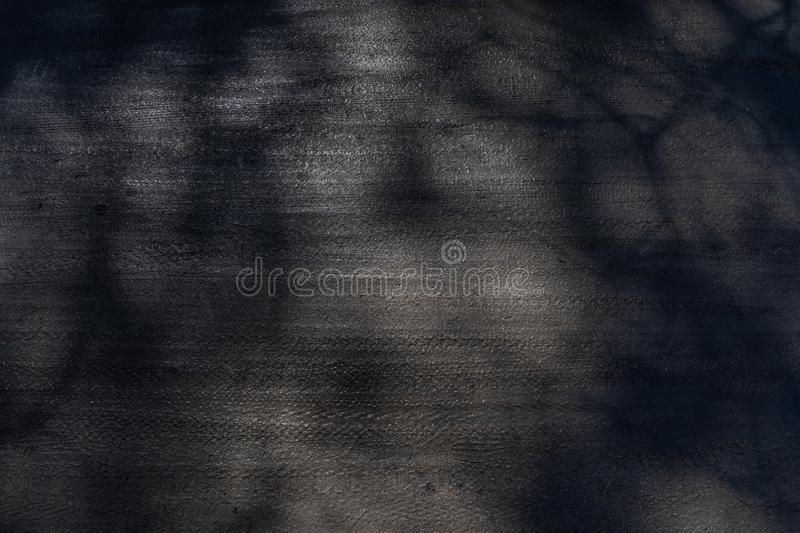 Dirt track with bicycle tire marks and spots of light and shade royalty free stock image