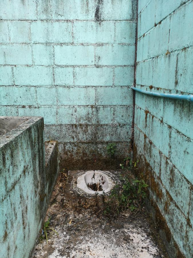 Dirty and abandoned squat toilet stock image