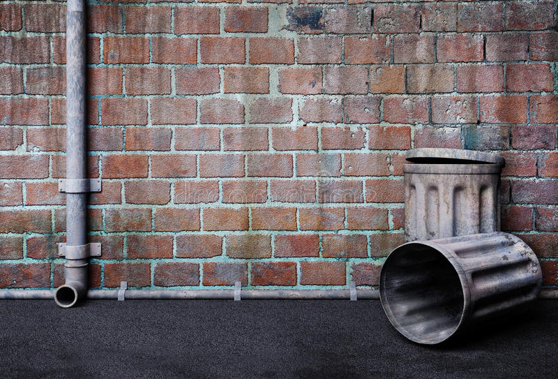Dirty alley. An empty wall of a dark and dirty alley on the back of a building, with empty trash cans stock illustration