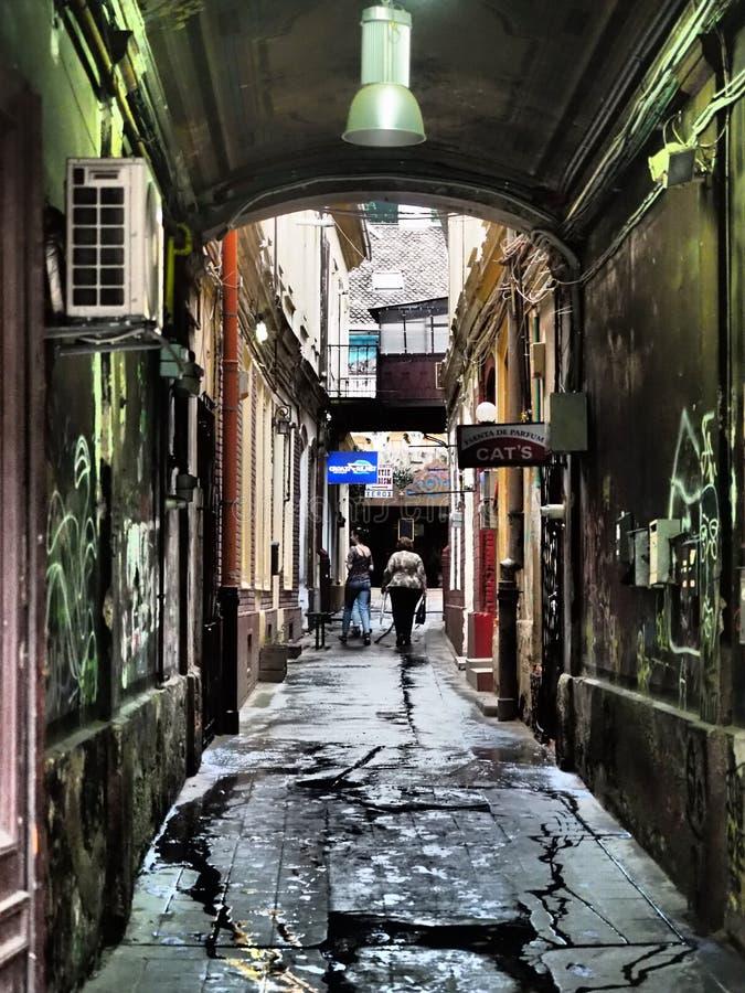 Dirty alleyway in Brasov, Romania royalty free stock image