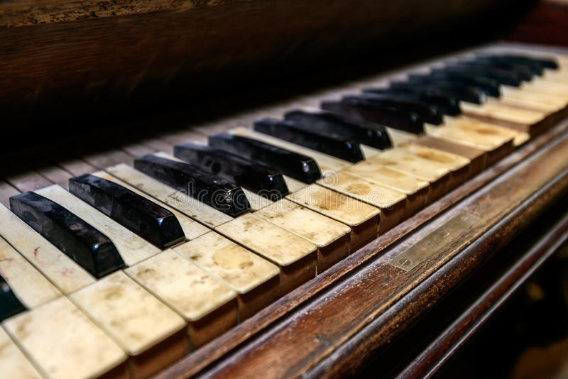 Dirty antique piano royalty free stock image