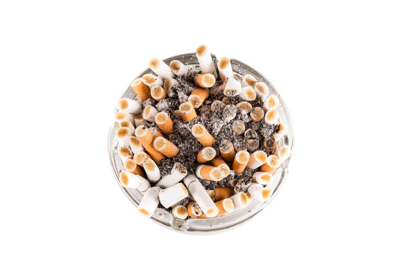 A dirty ashtray. With cigarette ash and butts stock image