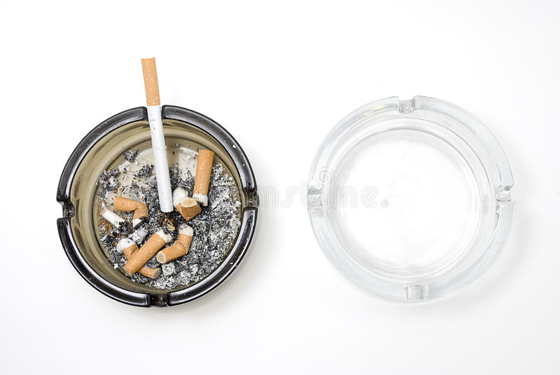 Dirty ashtray and clean ashtray royalty free stock photo