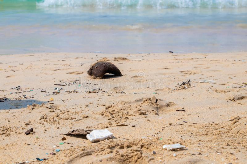 Dirty beaches.Caused by the dumping of undisciplined. Pollution on the beach of tropical sea. Environmental pollution stock photography