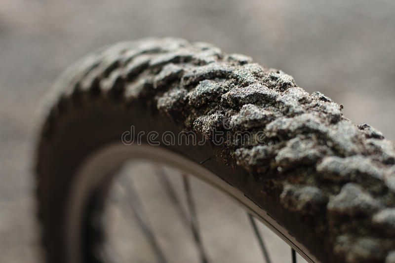 Dirty bicycle tire. Closeup of a dirty mountainbike tire stock photography