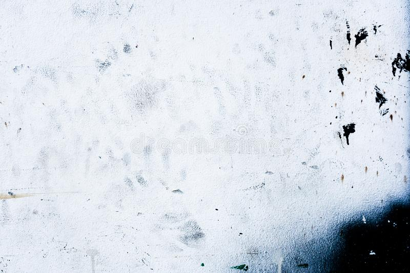 Dirty black painted stains on white cement wall texture stock photos