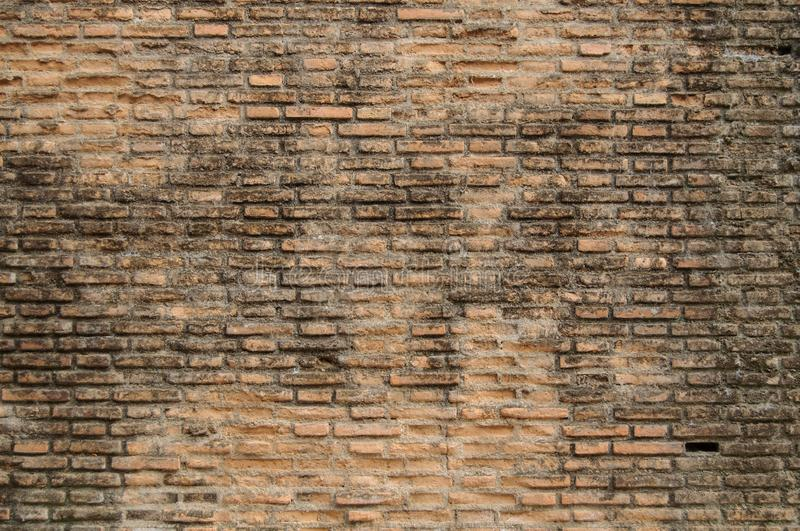 Dirty Brick Very Old Building Facade Vintage Wall Texture Overlay. Pattern texture background or as art design overlay. Building old facade stock image