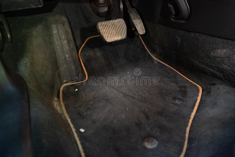 Dirty car floor mats of black carpet with gas pedals and brakes in the workshop for the detailing vehicle before dry. Cleaning stock photos