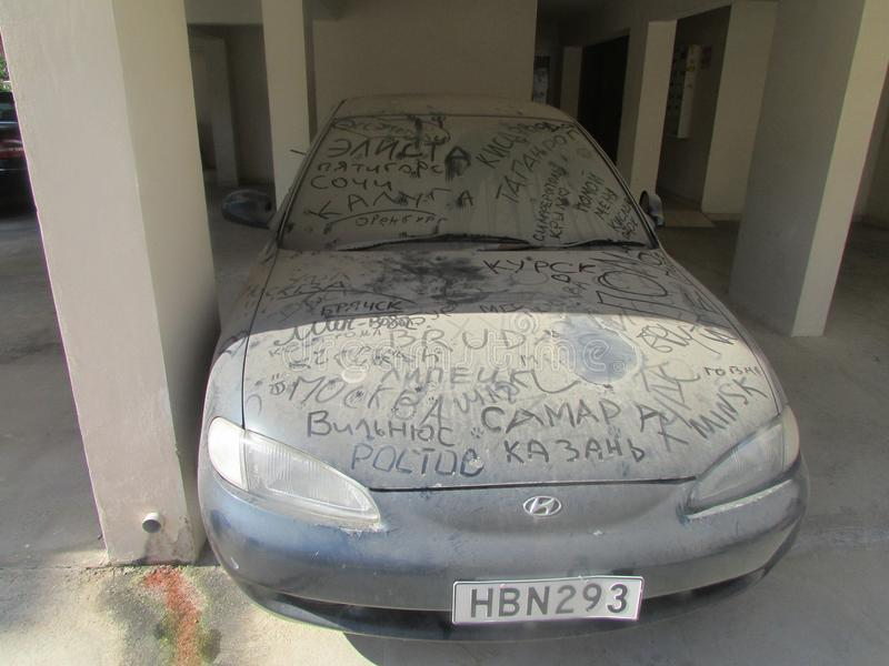 Dirty car next to the hotel for Russian tourists. stock images