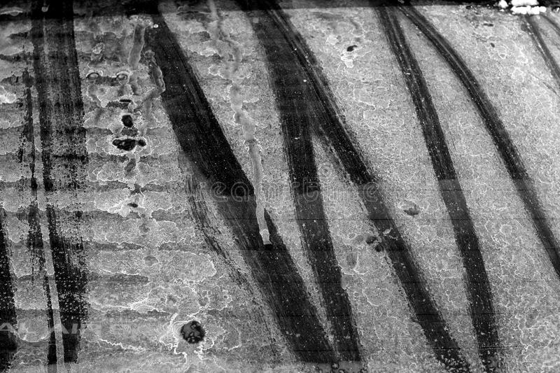 Dirty car rear window in black and white. Abstract background and texture for design royalty free stock photo