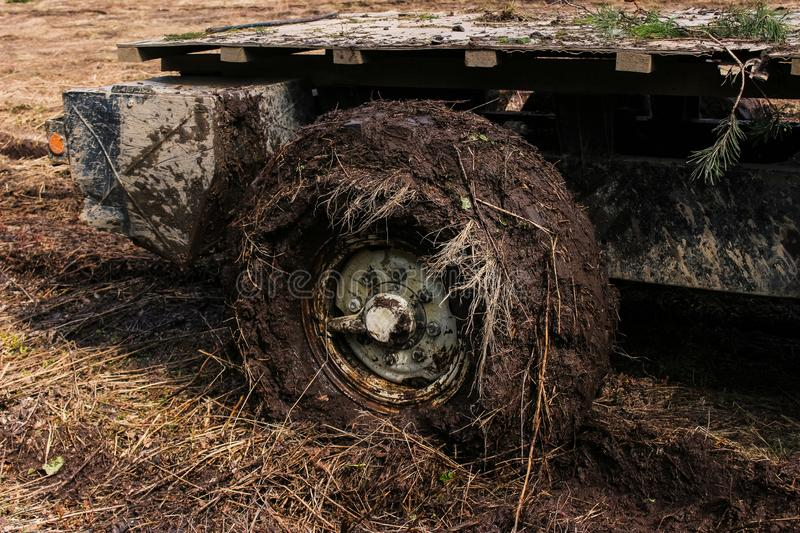 Dirty car wheel close up. Off-road in the spring forest. Moscow region royalty free stock images
