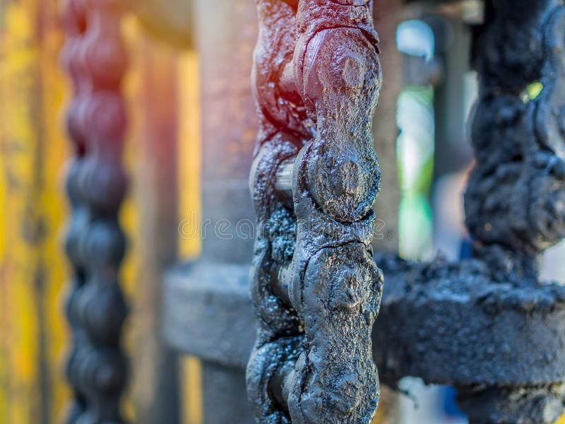 Dirty chain of forklifts. Close-up dirty and greasy chain of old forklifts with engine oil and lifting hydraulic cylinder royalty free stock photos