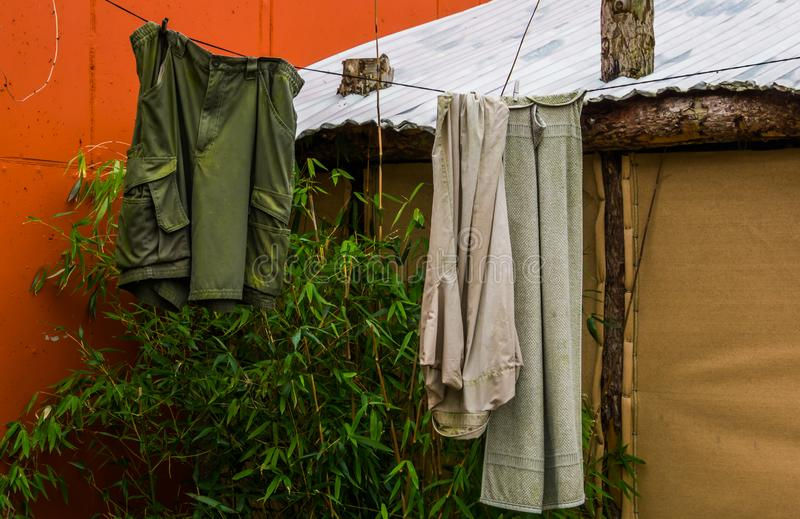 Dirty clothes hanging on a wash line, outdoor hiking, living in nature. Some Dirty clothes hanging on a wash line, outdoor hiking, living in nature stock photo