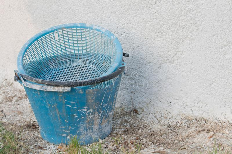 Dirty concrete bucket in construction area royalty free stock photo