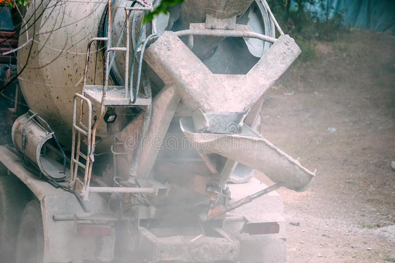 Dirty concrete mixer closeup. Construction machinery at a construction site. Dust technology stock photo