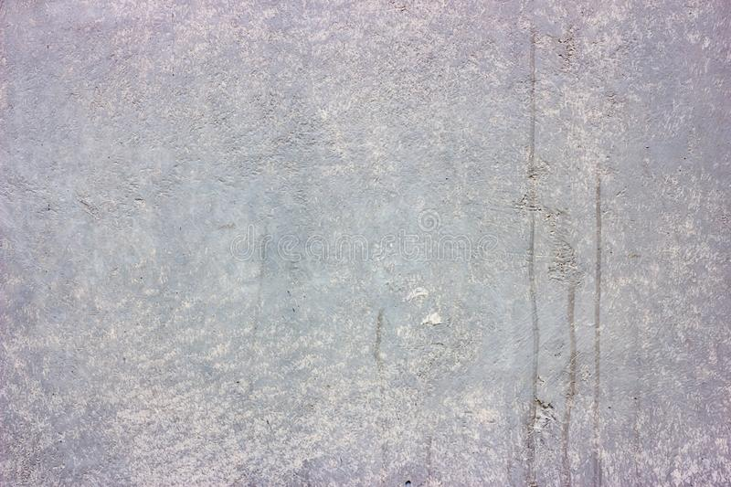 Dirty cracked old grunge vintage light gray concrete and cement mold texture wall or floor background stock photography